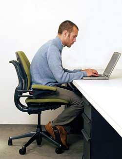 choosing an office chair. typing at a keyboard or laptop on worksurface is how many computer users spend their workdayu2014not being supported by chair choosing an office