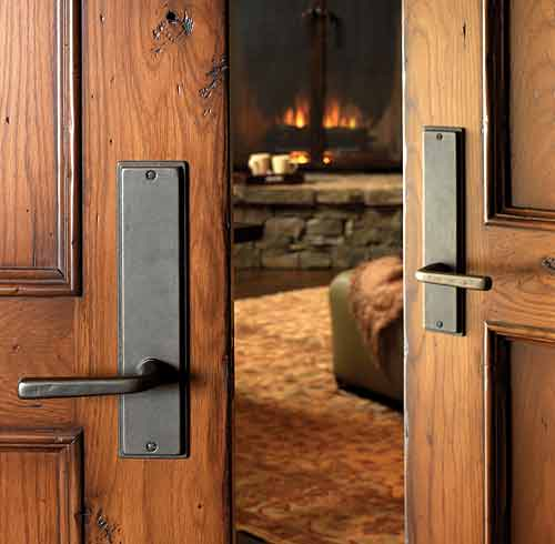 Passage Hardware On Double Doors Shown In Silicon Bronze With A Dark Patina.